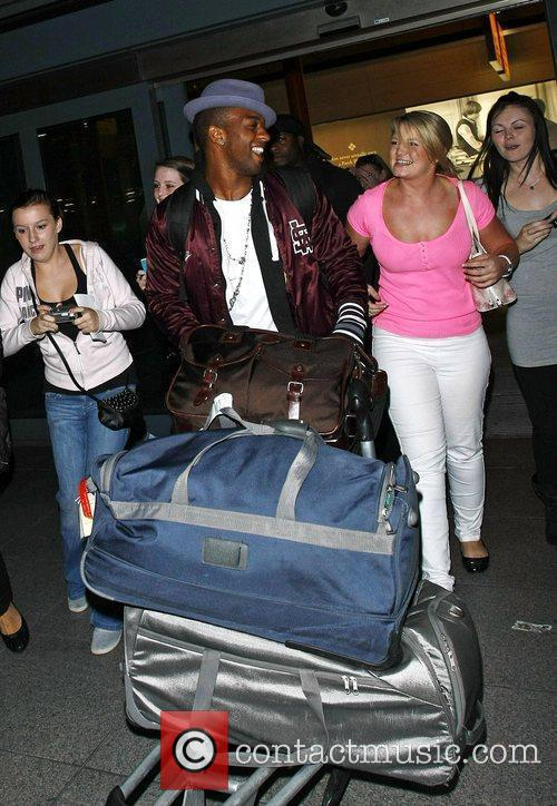 JLS are mobbed by fans as they arrive...