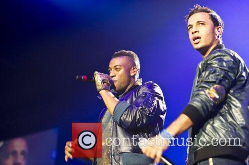 Oritse Williams and Aston Merrygold of JLS performing...
