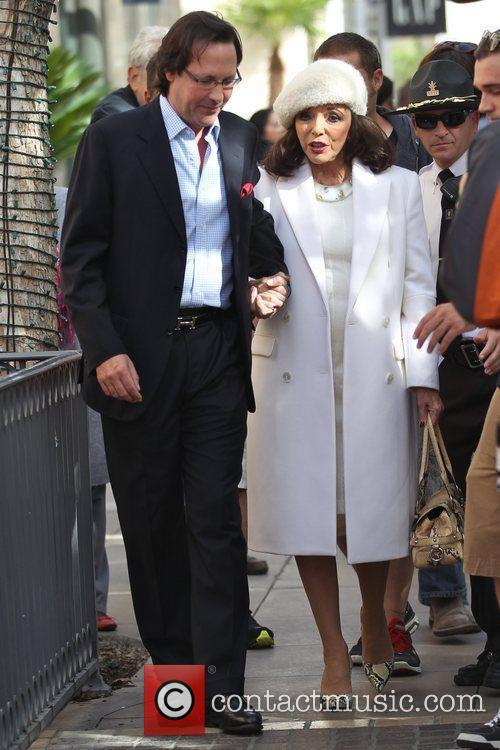 Joan Collins chats with Mario Lopez of the...