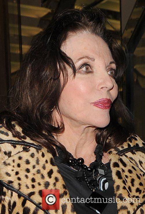 Joan Collins leaving the Ivy Club, wearing a...