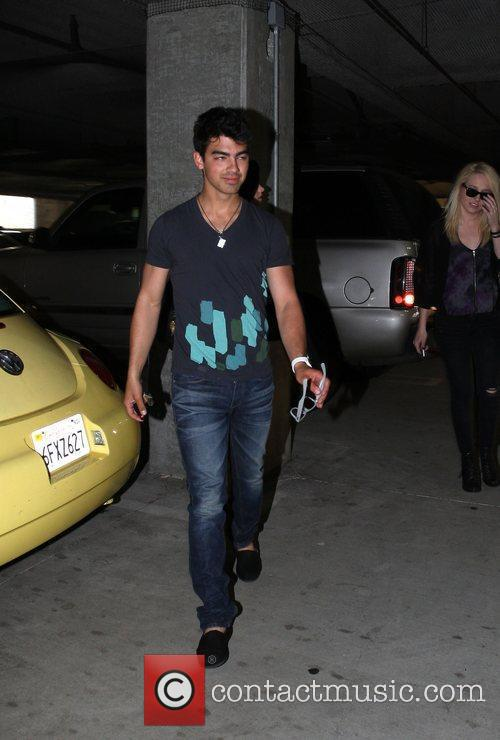 Demi Lovato and Joe Jonas go to church,...