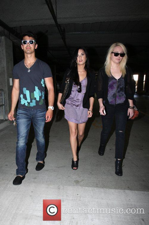 Demi Lovato, Joe Jonas go to church, Joe arrives wearing his slippers