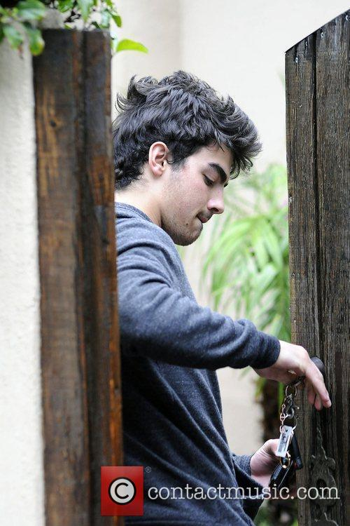 Joe Jonas arrives at his house in Los...