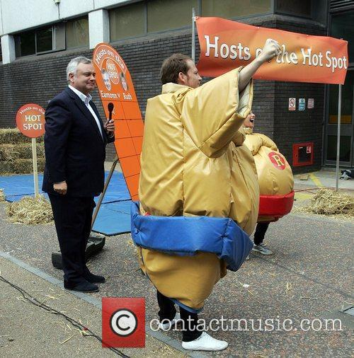 Eamonn Holmes and Joes Swash outside the 'This...