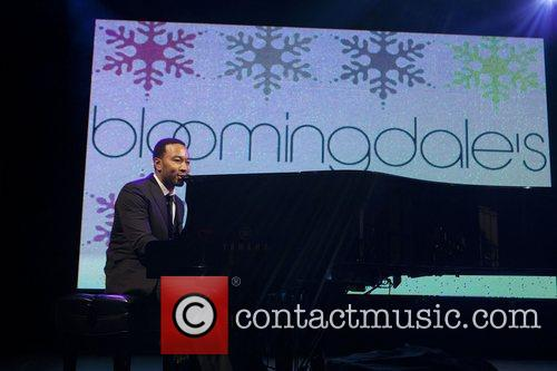 Performing as Bloomingdale's 59th Street unveil their holiday...