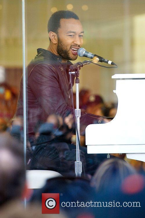 John Legend performing live in a free concert...