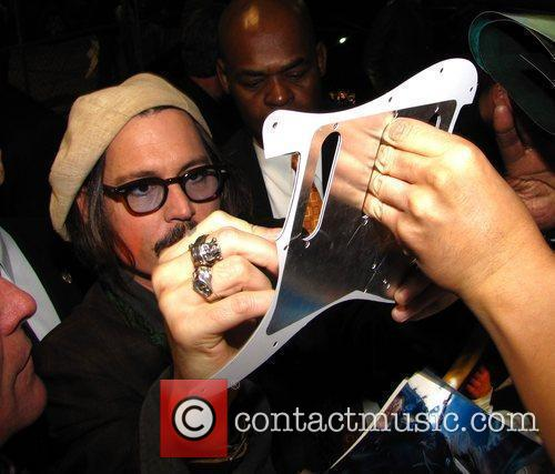 Johnny Depp signs autographs for fans outside Hot...