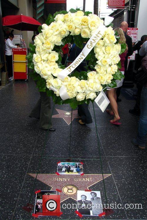 A wreath is placed on the Hollywood Walk...