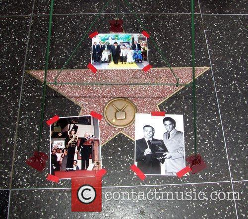 Tributes are placed on the Hollywood Walk Of...