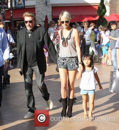 Johnny Hallyday and his wife Laeticia Boudou shop...