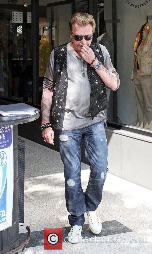 Johnny Hallyday  leaving Cafe Roma after having...