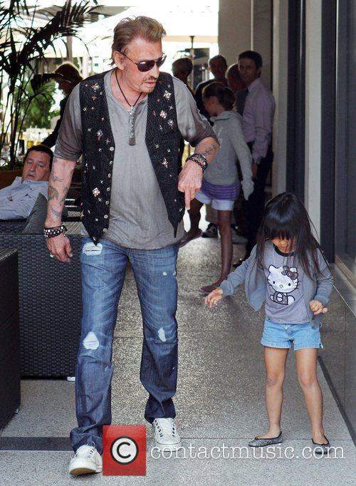 Johnny Hallyday and his daughter Jade leaving Cafe...