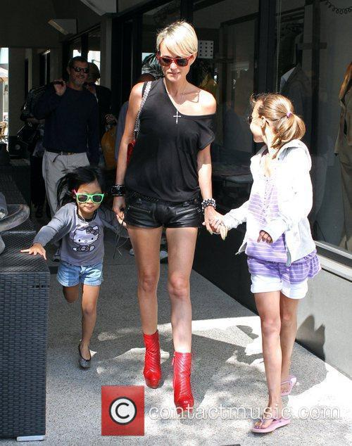 Laeticia Hallyday  leaving Cafe Roma with her...