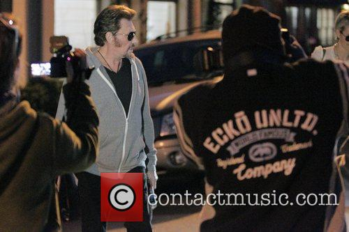 Johnny Hallyday and his wife Laetitia Boudou leaving...