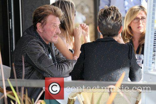 Johnny Hallyday eating lunch with his wife and...