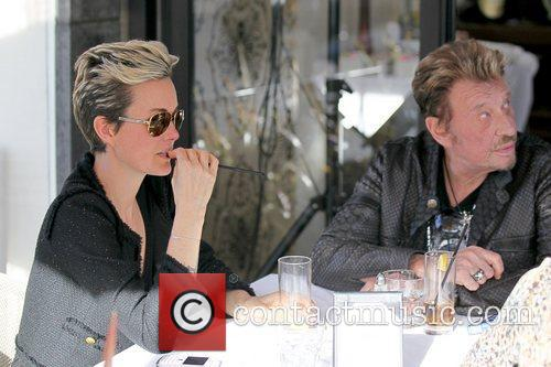 Laeticia Boudou and Johnny Hallyday Johnny Hallyday eating...