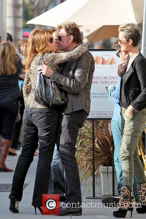 Johnny Hallyday kissing a friend goodbye Johnny Hallyday...