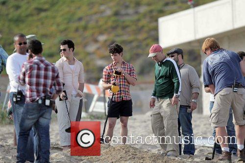 Kevin Jonas and Nick Jonas filming on location...