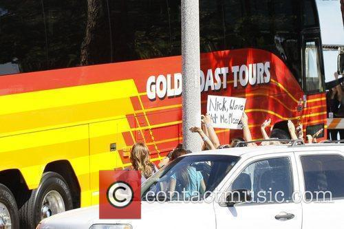Atmosphere Jonas Brothers board a tour bus after...