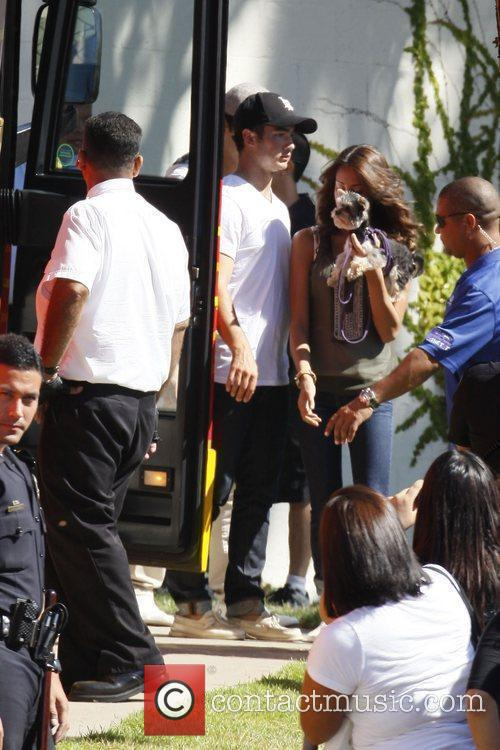 Jonas Brothers board a tour bus after winning...