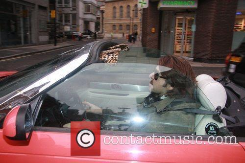 Jonathan Ross driving his car in central London...