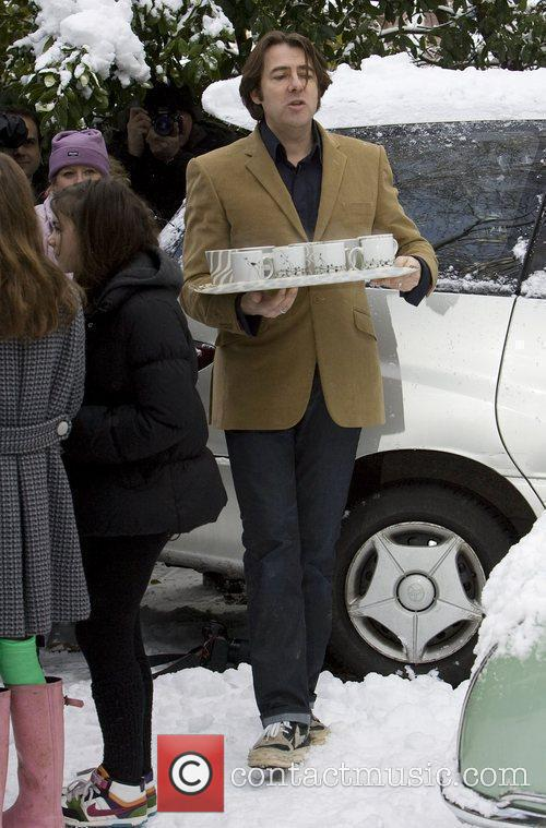 Jonathan Ross carries tea to journalists outside his...