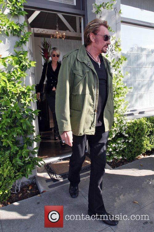 Jonny Hallyday and wife Laeticia Boudou seen leaving...