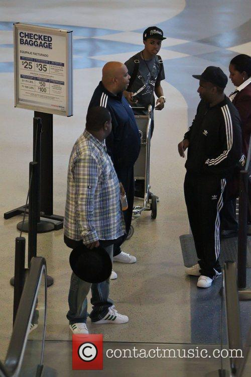 Joseph Simmons and friends seen going through security...