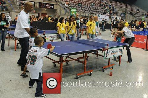 Jason Taylor plays ping pong with his family...