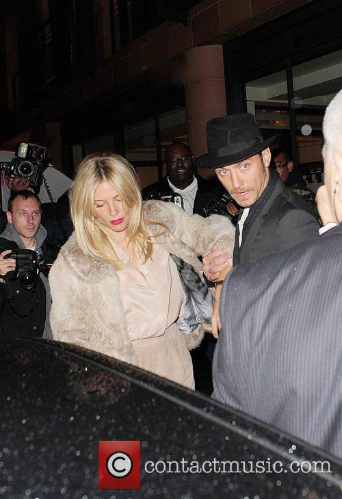 Jude Law and Sienna Miller leave C London...