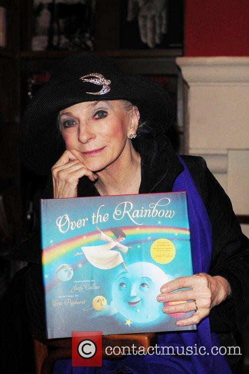 Judy Collins  signs copies of her book...