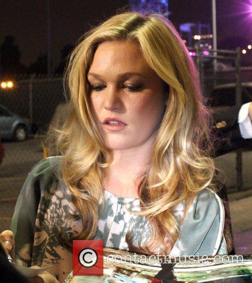 Julia Stiles signs autographs for fans as she...