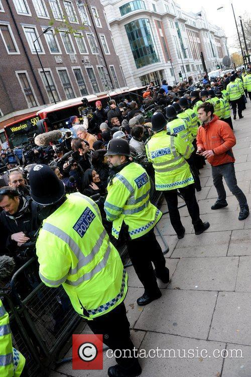 Members of the media gather at Westminster Magistrates...