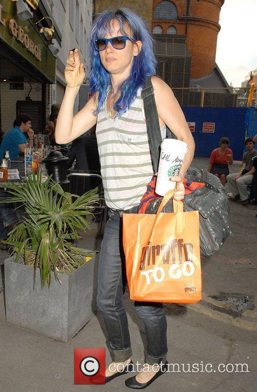Juliette Lewis, sporting blue hair and wearing no...