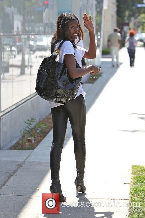 English television presenter June Sarpong, wearing leather leggings,...