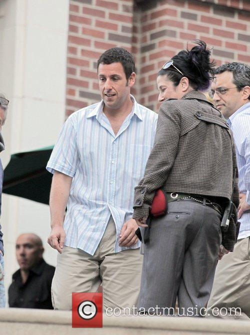 Actor Adam Sandler takes a break from filming...