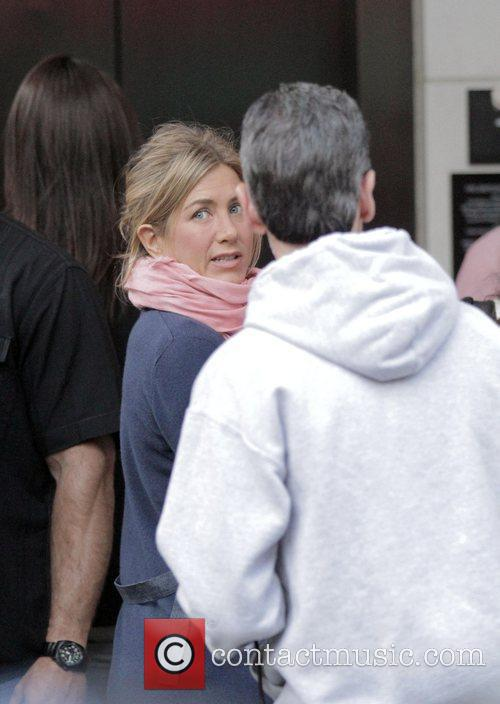 Actress Jennifer Aniston takes a break from filming...