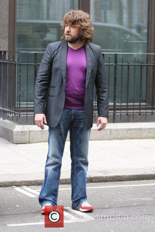 Justin Lee Collins wearing a tight purple t-shirt...