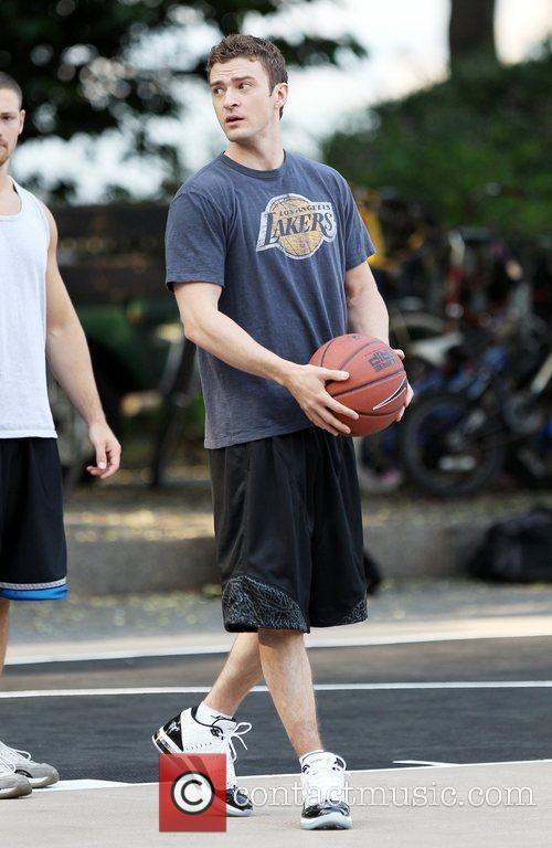 Plays basketball on the set of the new...
