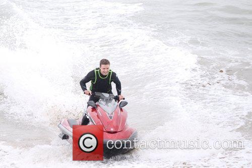 Rides a jet ski while filming 'Friends with...