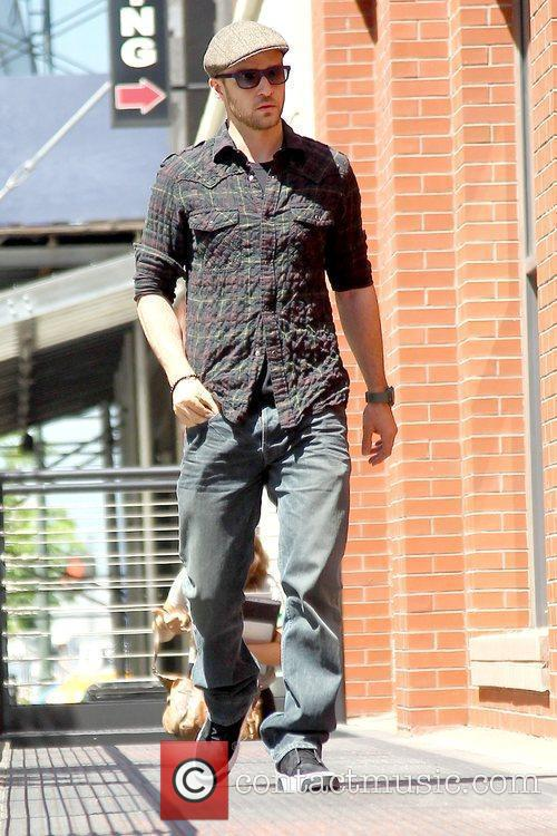 Arriving at his Manhattan hotel wearing a plaid...