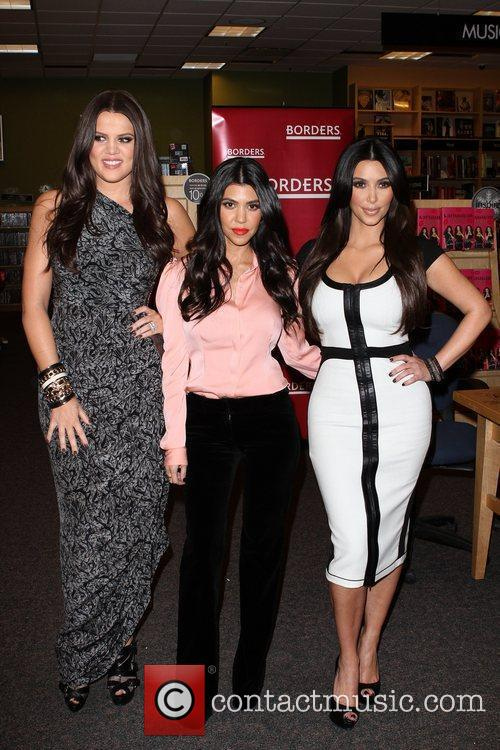 Khloe Kardashian, Kim Kardashian and Kourtney Kardashian 11