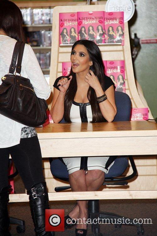 Kardashian sisters sign copies of their new book...