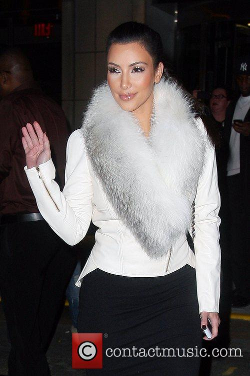 Kim Kardashian and Leaves 9