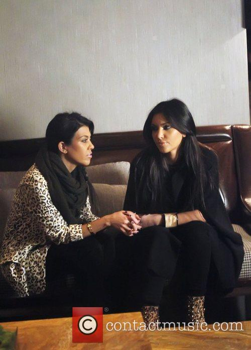 Kourtney Kardashian and Kim Kardashian 4