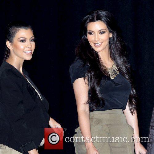 Kourtney Kardashian and Kim Kardashian 8