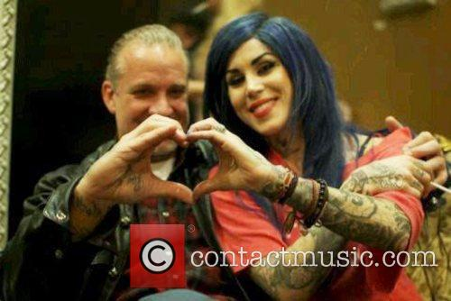 Kat Von D makes a heart with Jesse...