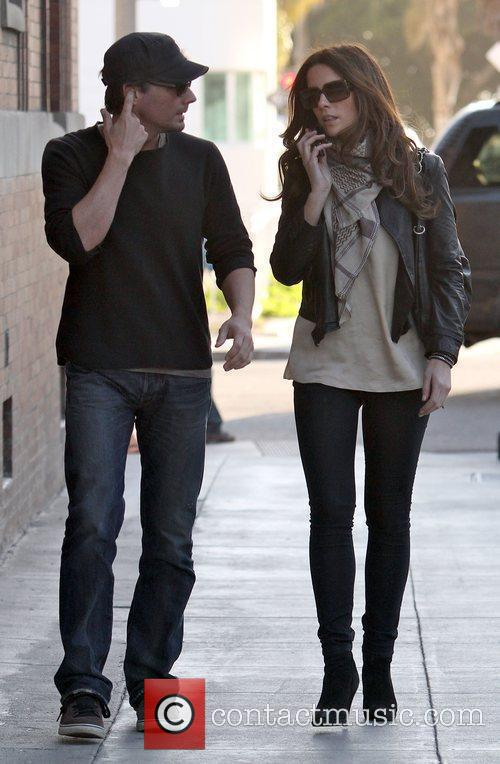 Holding her husband Len Wiseman's hand, while going...