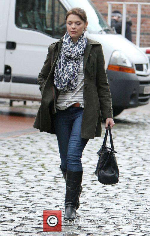 Kate Ford trips on some cobbles as she...