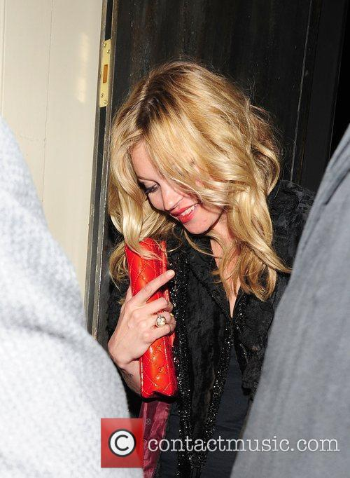 Kate Moss leaves Chinawhites Night Club clutching a...